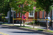 Vincent Yonai (R) of Mifflinburg used caution tape to block off the sidewalk on half a block of Chestnut Street during the Mifflinburg Pride Event. As a pedestrian entered the taped-off area, Yonai retrieved a bat and went toward the man in a threatening manner and demanded that he get off of the sidewalk. Yonai was eventually taken away in handcuffs by Mifflinburg Police.