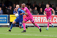 AFC Wimbledon striker Joe Pigott (39), battles for possession with Rochadale attacker Calvin Andrew (9) during the EFL Sky Bet League 1 match between AFC Wimbledon and Rochdale at the Cherry Red Records Stadium, Kingston, England on 5 October 2019.