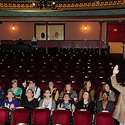 Programming coordinator Chris Curtis talks about the theater's rennovation with Members of Arts In Reach gather in the lobby of The Music Hall before a Q/A session with members of the comedy team Women Fully Clothed