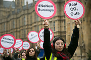 Anti-airport expansion activists stage a protest outside Parliament October 25th 2016, in London, United Kingdom.  On the morning of the Conservative Governments announcement to expand Heathrow with a new runway, climate activists protest against any further expension to protect the climate and local communities. Activists are dressed up as mock air craft controllers and some block a mock runway in mock arm locks.
