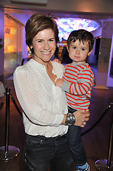 HARRIET SCOTT and her son LOUIS at a tea party to celebrate the launch of the limited edition Heart & Sole shoe collection by Step2wo in aid of the British Heart Foundation's Mending Broken Hearts Appeal, held at Aubaine on 2, Selfridge's, Oxford Street, London on 4th July 2012.