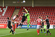 Glenn Morris (1) of Crawley Town punches clear during the EFL Sky Bet League 2 match between Cheltenham Town and Crawley Town at Jonny Rocks Stadium, Cheltenham, England on 10 October 2020.