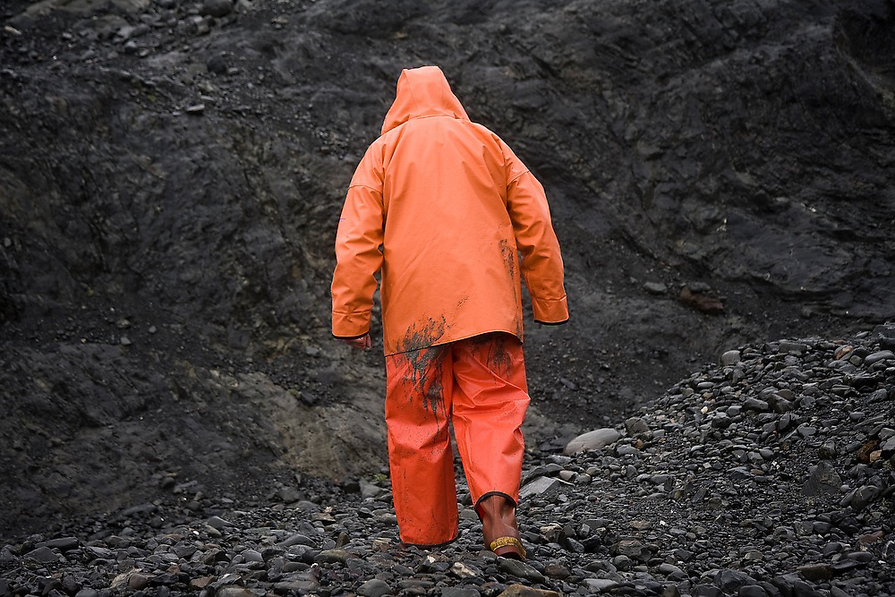 Dr. Tad Pfeffer, a glaciologist at the University of Colorado (INSTAAR), at camp during a storm at the Columbia Glacier, Chugach Mountains, Alaska.