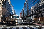 """Trucks used as a road block in Washington D.C.'s """"Green Zone'""""ahead of inauguration to  secure Biden's inuguration after the insurgency on Jan. 6, 2021."""