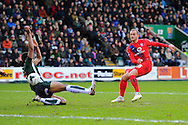 York City's Lewis Alessandra had a shot during the Sky Bet League 2 match between Plymouth Argyle and York City at Home Park, Plymouth, England on 28 March 2016. Photo by Graham Hunt.