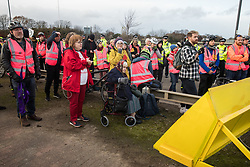 London, UK. 8 December, 2019. Sipson residents Christine Taylor, Jane Taylor and Sheila Taylor join climate activists from Extinction Rebellion outside Heathrow airport at a Bikes Against Bulldozers protest against Heathrow expansion and the greenwashing of climate commitments by political parties. The protest took the form of a Critical Mass bicycle ride from Hyde Park followed by a lie-in in front of a full-scale mock-up of a bulldozer to which Boris Johnson and John McDonnell were invited in order to fulfil their pledge of lying down in front of bulldozers to be used for Heathrow expansion.