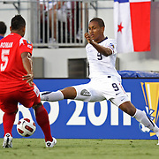 USA forward Juan Agudelo (9) defends against Panama defender Roman Torres (5) during a  CONCACAF Gold Cup soccer match between the United States and Panama on Saturday, June 11, 2011, at Raymond James Stadium in Tampa, Fla. (AP Photo/Alex Menendez)