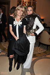 Left to right, RACHEL JOHNSON and JEANNE MARINE at a dinner hosted by Pablo Ganguli and Ella Krasner to celebrate the 10th Anniversary of Liberatum and in honour of Sir Peter Blake held at The Corinthia Hotel, Nortumberland Avenue, London on 23rd November 2011.