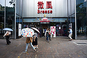 Shoppers and pedestrians at an entrance to one of Taipei's department store complexes.