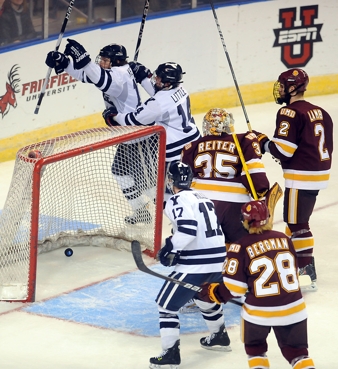 NCAA East Regional Final, Div. 1 Hockey between Yale and Univ. of MN-Duluth, 3rd period. Yale scores its third goal against UM-D. Yale left to right: Denny Kearney, Broc Little, and Andrew Miller (#17). UMD goalie Kenny Reiter, #28 Wade Bergman, and #2 Brady Lamb. Photo by Mara Lavitt/New Haven Register<br /> <br /> 3/26/11