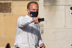 © Licensed to London News Pictures. 16/06/2021. London, UK. Foreign Secretary Dominic Raab points as he walks in The Houses of Parliament. Earlier today former chief advisor to number 10, Dominic Cummings, released a series of private WhatsApp conversations with Prime Minister Boris Johnson, in which the PM was critical of the health secretary.  Photo credit: George Cracknell Wright/LNP
