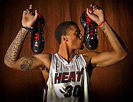 9/26/2008 Al Diaz / Miami Herald Staff -- The Miami Heat's media day at the American Airlines Arena. Here Michael Beasley, the Heats first round draft pick,shows off his own shoes Adidas during media day.