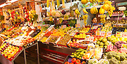 Fruit and vegetable stall in historic market building in Triana, Seville, Spain