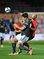Football - 2020 / 2021 EFL Carabao Cup - Round Three - Luton Town vs Manchester United<br /> <br /> Luton Town's Danny Hylton battles for possession with Manchester United's Harry Maguire, at Kenilworth Road.<br /> <br /> COLORSPORT/ASHLEY WESTERN