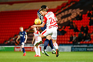 Doncaster Rovers midfielder James Coppinger (26) wins the header during the EFL Sky Bet League 1 match between Doncaster Rovers and Southend United at the Keepmoat Stadium, Doncaster, England on 12 February 2019.