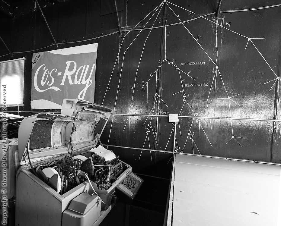 Wall mural of cosmic rays, and the old teletype machine used for recording/transmitting data.<br /> One of the three Cos-Ray neutron monitor stations at McMurdo was taken down in the 2014-15 season, and reinstalled at the Korean base Jang Bogo in December, 2015.  The other two stations will be removed in the 2016-17 season and installed at Jang Bogo in the 2017-18 season.