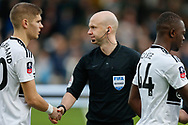 Referee Anthony Taylor shaking hands with players before The FA Cup 3rd round match between Fulham and Oldham Athletic at Craven Cottage, London, England on 6 January 2019.
