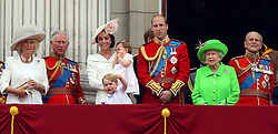 File photo dated 11/06/16 of the Duke and Duchess of Cambridge with their children Princess Charlotte and Prince George, Queen Elizabeth II, the Duke of Edinburgh, the Duchess of Cornwall and the Prince of Wales on the balcony of Buckingham Palace, London, after they attended the Trooping the Colour ceremony. The Duke and Duchess of Cambridge will celebrate their daughter Princess Charlotte's second birthday on Tuesday.
