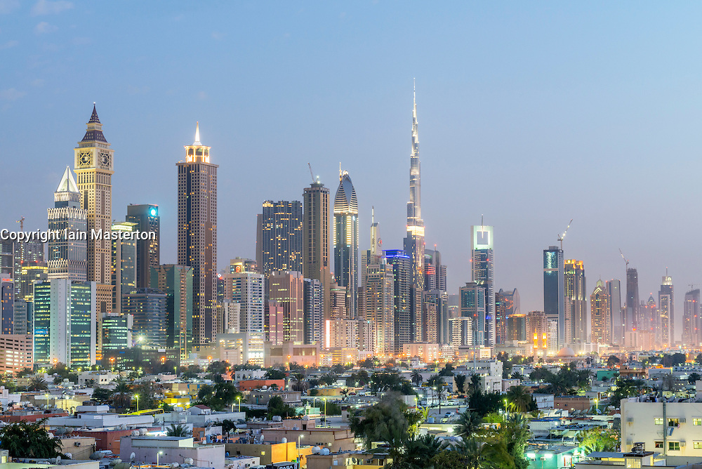 Skyline of Dubai at dusk from Satwa district in United Arab Emirates