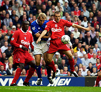 Photo. Jed Wee.<br /> Liverpool v Leicester City, FA Barclaycard Premiership, Anfield, Liverpool. 20/09/2003.<br /> Liverpool's Michael Owen (R) controls the ball despite the presence of Leicester's James Scowcroft (C) as Emile Heskey looks on.