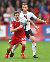 Charlton Athletic's Krystian Bielik and Accrington Stanley's Sam Finley battle for the ball