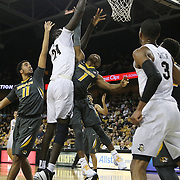 ORLANDO, FL - NOVEMBER 30: Tacko Fall #24 of the UCF Knights scores in front of Terrence Phillips #1 and Jontay Porter #11 of the Missouri Tigers during a NCAA basketball game  at the CFE Arena on November 30, 2017 in Orlando, Florida. (Photo by Alex Menendez/Getty Images) *** Local Caption *** Tacko Fall; Terrence Phillips; Jontay Porter