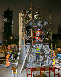 © Licensed to London News Pictures. 12/06/2020. London. Monument restoration and conservation workers covering a statue of Winston Churchill in Westminster, central London. Demonstrations from anti-racist and right wing groups are planned over the weekend in central London. Photo credit: Marcin Nowak/LNP