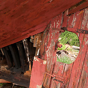 """19th century """"Friendship Sloop"""" rests at the Harold Burnham Shipyard in Essex Massachusetts. Burnham is the 28th member of his family to make and restore wooden boats on the Essex River"""