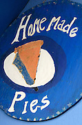 """Hand-painted sign advertising """"Home Made Pies"""" at Wild Blueberry Land, a quirky roadside attraction in Downeast Maine."""