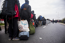 October 24, 2016 - Calais, France - Refugees arriving and waiting at the hangar of distribution of refugees with their luggage in Calais, France on october 24, 2016. The dismantling of the jungle began Monday morning. Refugees come accompanied by the associations to the starting center ''C.A.O.''. Police frames the device. More than 850 press credentials were distributed. (Credit Image: © Julien Pitinome/NurPhoto via ZUMA Press)
