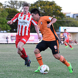 BRISBANE, AUSTRALIA - FEBRUARY 25: Nathan Yoon of Brisbane Roar controls the ball under pressure from Kristen Waters of Olympic FC during the NPL Queensland Senior Men's Round 1 match between Olympic FC and Brisbane Roar Youth at Goodwin Park on February 25, 2017 in Brisbane, Australia. (Photo by Patrick Kearney/Olympic FC)