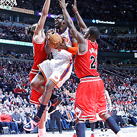 12 March 2012: New York Knicks power forward Amare Stoudemire (1) goes to the basket between Chicago Bulls center Joakim Noah (13) and Chicago Bulls guard Jimmy Butler (21) during the Chicago Bulls 104-99 victory over the New York Knicks at the United Center, Chicago, Illinois, USA.