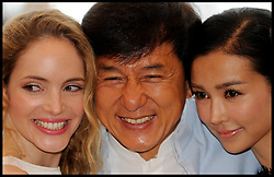 L TO R Laura Weissbecker (white dress,left) Jackie Chan, Yeo Xingtong pose for photographers in Cannes while promoting Jackie Chan's new film Chinese Zodiac, Friday 18th May 2012. Photo by Andrew Parsons/i-Images.