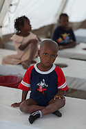 Youn boy being treated at Martissant 25 , a cholera treatment center in Port-au-Prince run by Doctors without Boarders (MSF) that treats hundreds of cholera patients a day.