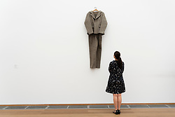 Woman looking at art installation Felt Suit ( Filzanzug) by Joseph Beuys at Hamburger Bahnhof art museum in Berlin, Germany .Editorial Use Only.