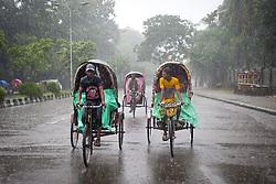August 3, 2017 - Dhaka, Bangladesh - Rickshaw puller transport passenger when heavy rainfall made in Dhaka city. Last few days in Dhaka city heavy rainfall created floods in various place. (Credit Image: © K M Asad via ZUMA Wire)