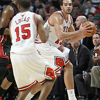 14 March 2012: Chicago Bulls center Joakim Noah (13) looks to pass the ball during the Chicago Bulls 106-102 victory over the Miami Heat at the United Center, Chicago, Illinois, USA.