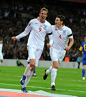 Peter Crouch Celebrates Scoring goal with team mate Gareth Barry<br /> England 2008/09<br /> England V Ukraine 01/04/09 World Cup Qualifier at Wembley Stadium <br /> Photo Robin Parker Fotosports International