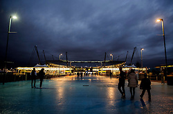 Fans make their way to the ground before the match - Photo mandatory by-line: Rogan Thomson/JMP - Tel: 07966 386802 - 18/02/2014 - SPORT - FOOTBALL - Etihad Stadium, Manchester - Manchester City v Barcelona - UEFA Champions League, Round of 16, First leg.