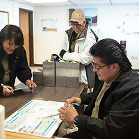 Kerry Bowekaty, right, Gallup Express driver supervisor and dispatcher collects tally sheets from bus drivers Lupe Bond, center, and Julia Torres at the end of their shift Tuesday afternoon in Gallup. The tally sheets keep track of the routes and riders on a daily basis.