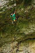 Steve McClure casually rinsing The Roof Warrior, 8a, Cheedale Cornice