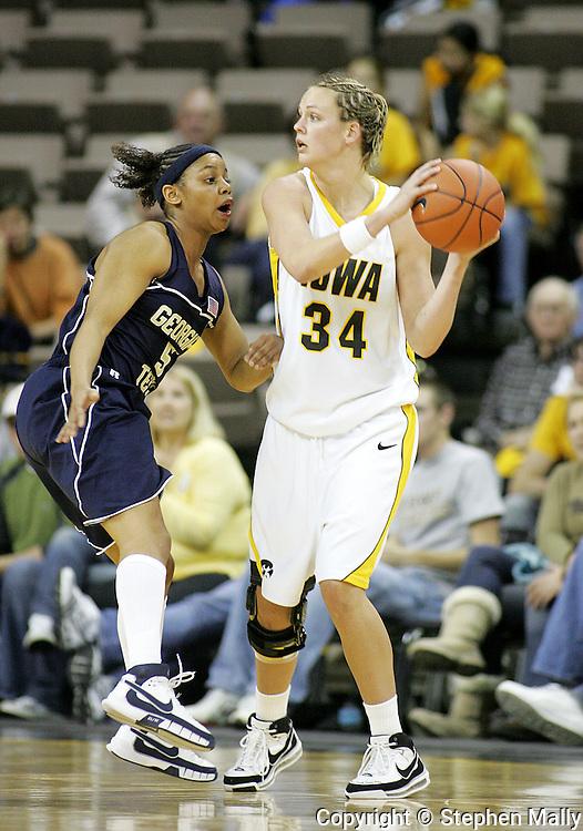 28 NOVEMBER 2007: Iowa forward Johanna Solverson (34) tries to pass the ball around Georgia Tech guard Jill Ingram (5) in the second half of Georgia Tech's 76-57 win over Iowa in the Big Ten/ACC Challenge at Carver-Hawkeye Arena in Iowa City, Iowa on November 28, 2007.
