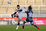 Wasps full back Lima Sopoaga puts up a high kick as Sale Sharks wing Marland Yarde tries to charge down during the Gallagher Premiership Rugby match Sale Sharks -V- Wasps  at The AJ Bell Stadium, Greater Manchester, England United Kingdom, Sunday, December 27, 2020. (Steve Flynn/Image of Sport)