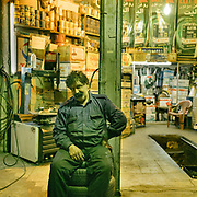 Mecanician taking a night shift at a car repair shop in Dorud city, Lorestan. <br /> <br /> Travelling over 4000km by train across Iran. An opportunity to enjoy Persian hospitality, discover Iran's ancient cities and its varied landscapes, from deserts to mountains.