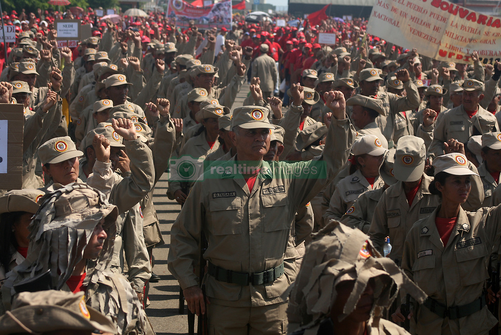 December 17, 2018 - Maracaibo, Venezuela - Great mobilization civic military people, Bolivarian National Armed Force, militia and indigenous people took place on 17 December 2018 in the city of Maracaibo, Venezuela. In commemoration of the 188 years of the death of the Liberator Simon Bolivar, and following orders of President Nicolas Maduro ''to close ranks, knee to ground, in combat for the defense of national dignity and sovereignty'' and categorically reject. The interventionist pretensions of the United States (USA), the European Union and the other countries of the continent, to be prepared and united to defend the national territory against any threat or group ''guerrilla, dissident, paramilitary, criminal or drug trafficker'' that threatens Venezuela. (Credit Image: © Humberto Matheus/NurPhoto via ZUMA Press)
