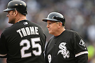 CHICAGO - APRIL 7:  Third base coach Jeff Cox #8 of the Chicago White Sox talks to Jim Thome during the game against the Minnesota Twins at U.S. Cellular Field in Chicago, Illinois on April 7, 2008.  The White Sox defeated the Twins 7-4.  (Photo by Ron Vesely)
