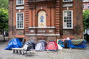 Tents belonging to people living on the street in London camped out behind the old Blewcoat School building for the poor on the corner of Caxton Street and Buckingham gate on the 25th of May 2021in Westminster, Central London. The Blewcoat school building was built in 1709 as a school for the poor which was used until 1926. The property is now owned by the Nation Trust. (photo by Andrew Aitchison / In pictures via Getty Images)