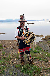 Alaska, Dancer-village leader, model released, seen while cruising the Southeast wilderness waterways on the Spirit of Discovery. Visit to Tlingit native village of Kake, population 800.  Photos of clothing design, totem pole, wood carver, world?s tallest totem pole at 132 feet, dances, male dancer (model released) and houses..Photo #: alaska10677 .Photo copyright Lee Foster, 510/549-2202, lee@fostertravel.com, www.fostertravel.com.