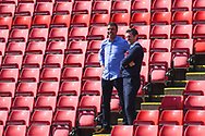 Sam Ricketts of Shrewsbury Town (Manager) and Sky Sports presenter Chris Kamara chat before the EFL Sky Bet League 1 match between Barnsley and Shrewsbury Town at Oakwell, Barnsley, England on 19 April 2019.