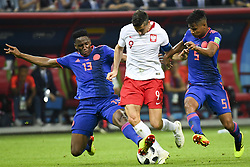 June 25, 2018 - Kazan, Russia - Robert Lewandowski of Poland fights for the bal with Yerry Mina and Wilmar Barrios of Colombia during the 2018 FIFA World Cup Group H match between Poland and Colombia at Kazan Arena in Kazan, Russia on June 24, 2018  (Credit Image: © Andrew Surma/NurPhoto via ZUMA Press)